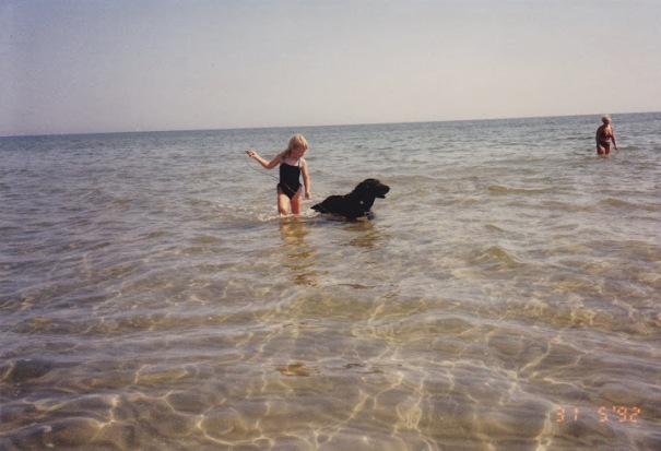 Me, my grandmother and Buster in the sea one summer